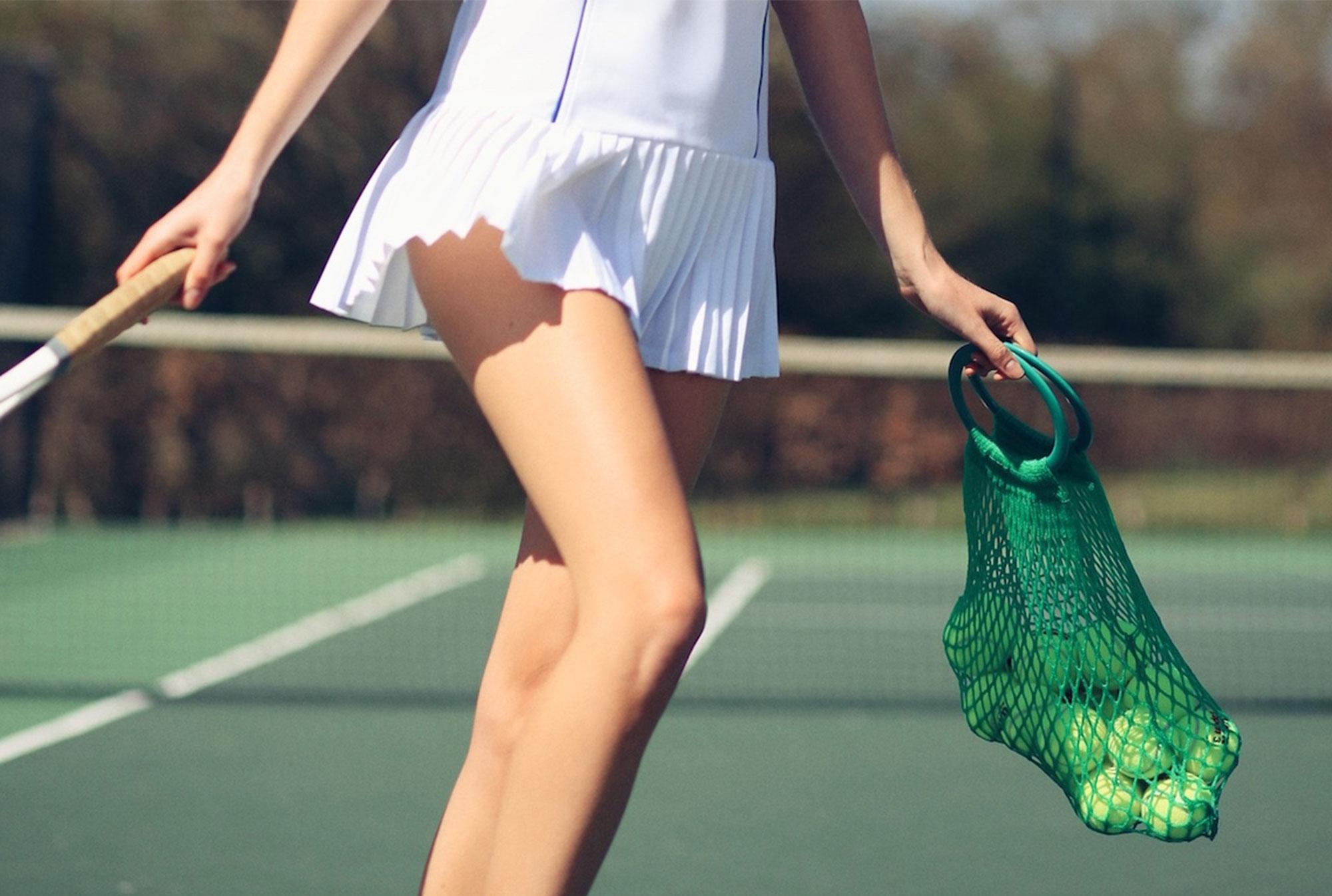 woman in tennis skirt