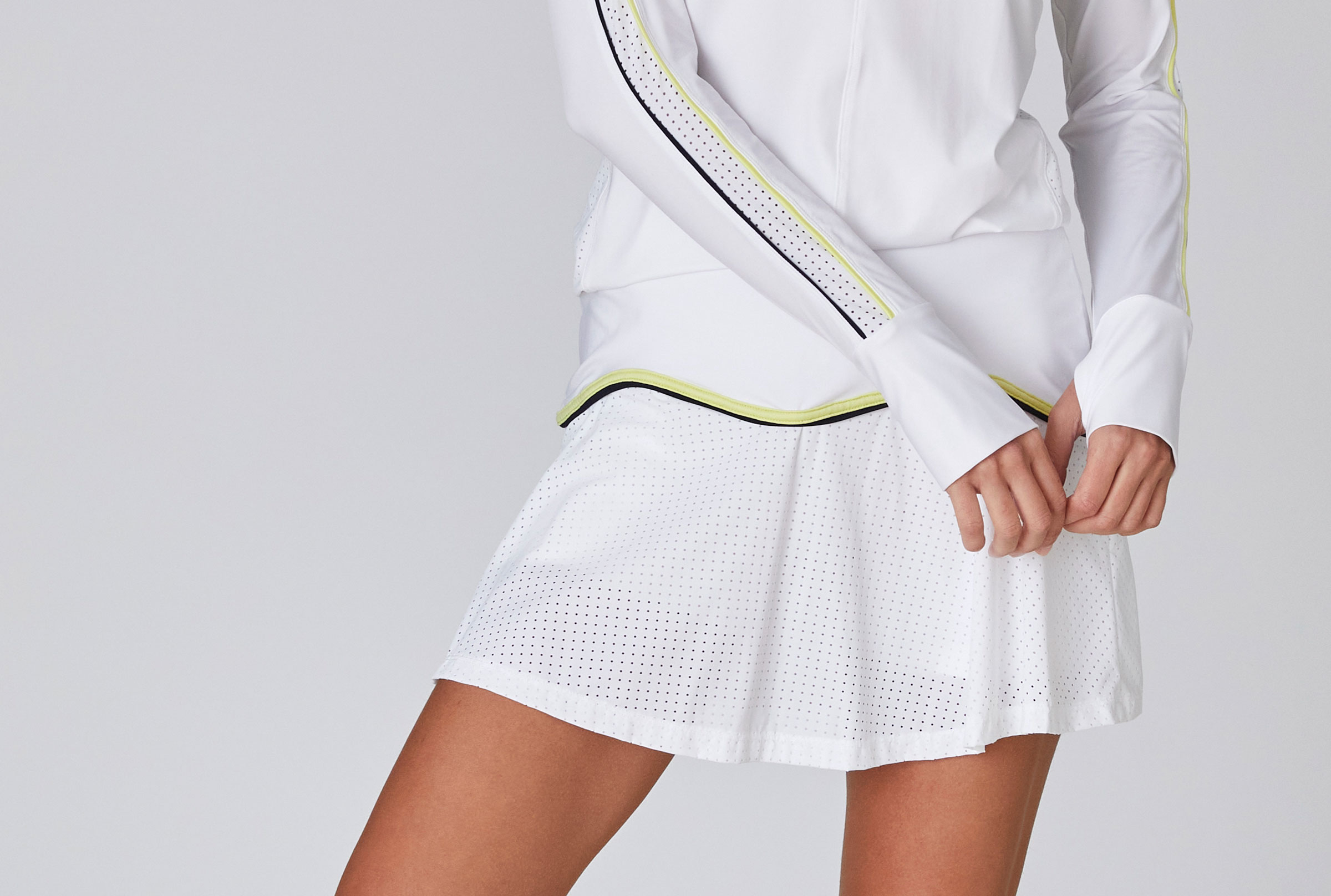 close up on woman modelling tennis outfit