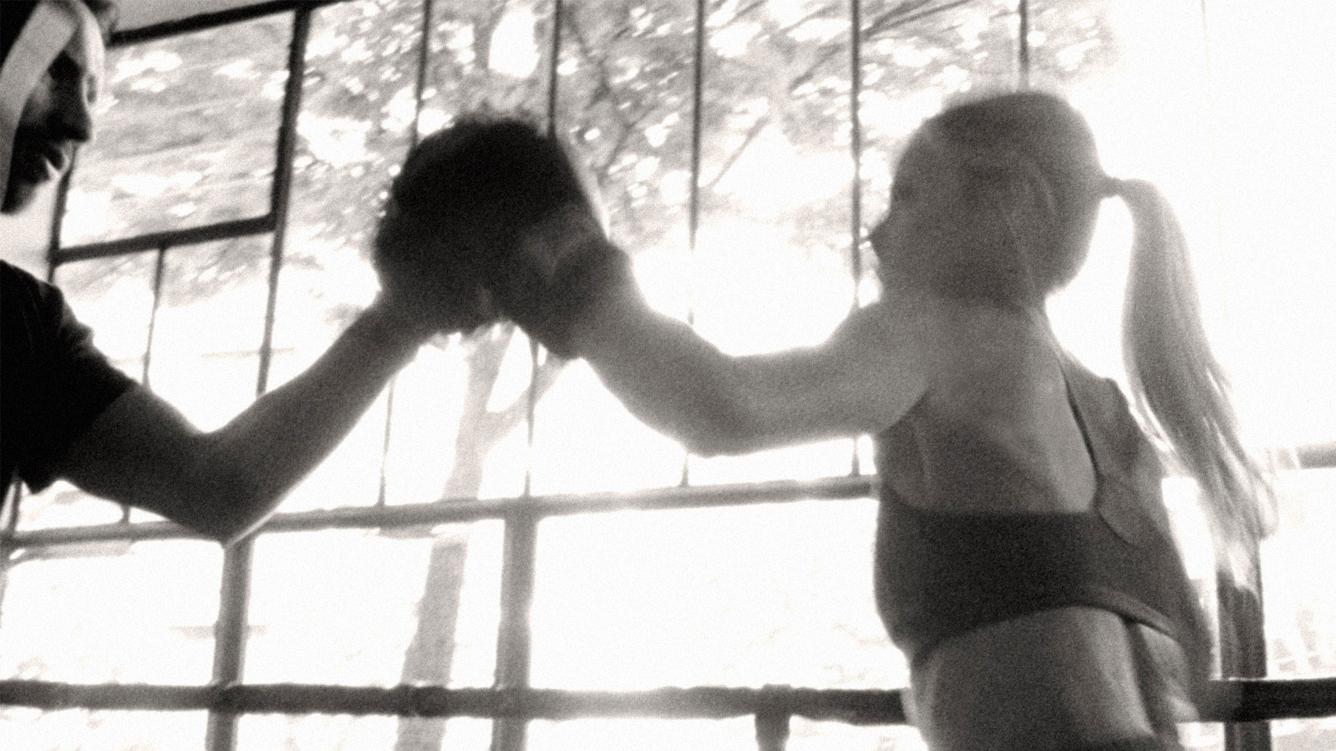 Black and white image of woman boxing