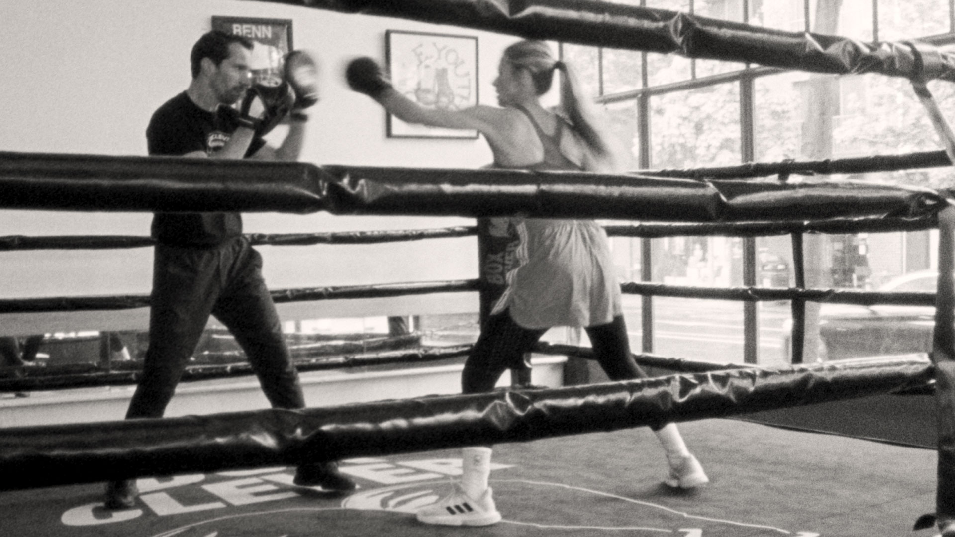 woman and man boxing in ring