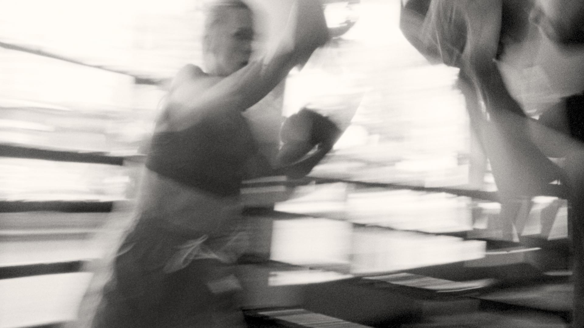 woman boxing blurry